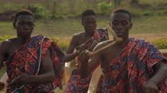 Tribes playing drum in field Stock Footage