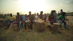Group of tribes playing drum in field, Ghana Stock Footage