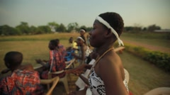 Group of tribes playing drum and dancing in field, Ghana Stock Footage