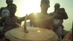 Tribe playing drum in field, Ghana Arkistovideo