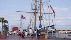 Tourist taking a walk alongside  Old San Juan Harbor waterfront. Stock Footage