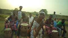 Tribal woman dancing and singing in field, Ghana - stock footage