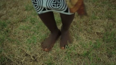 Tribal woman dancing and singing in field, Ghana Stock Footage