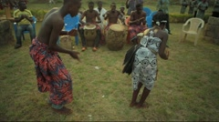 Tribes dancing in field, Ghana Arkistovideo