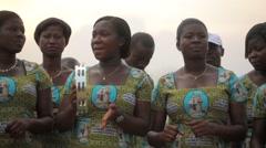 Local people singing in field, Ghana - stock footage