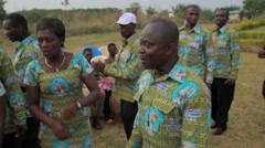 Local people singing and dancing in field, Ghana - stock footage