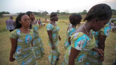 Local man singing religious song and dancing in field, Ghana Stock Footage