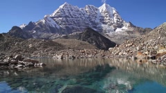 View of Glacial Lake and snowcapped mountain at Hongu Valley Stock Footage