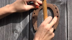 Woman nail horse shoe Stock Footage