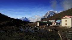 Time lapse of houses near snowcapped mountain, Imja Tsho, Imja Glacier, Nepal Stock Footage