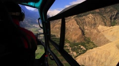 Helicopter moving over landscape in Mustang Stock Footage