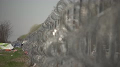 Barbed wire fence on the border Stock Footage