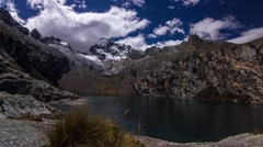 Time lapse of clouds over mountain range and lake, Peru Stock Footage
