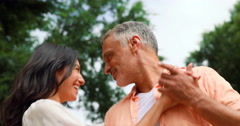 Smiling couple dancing Stock Footage