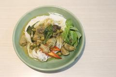 Curry chicken noodles (KHANOM CHIN). - stock photo