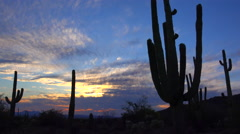 4K Serene Sunset Soaked Clouds Swirls Across Arizona Desert Time Lapse Stock Footage