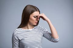 Pleasant cheerless girl feeling pain - stock photo