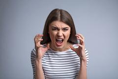 Pleasant girl expressing anger Stock Photos