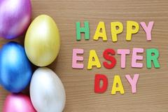 easter eggs on wood background,Handmade painted for design happy easter day. - stock photo