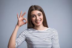 Nice girl expressing positivity Kuvituskuvat