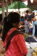 Young woman at the weekly market - stock photo
