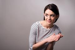 Pleasant  girl clapping hands - stock photo