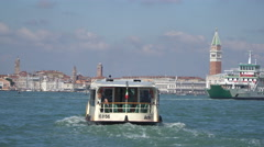 A vaporetto heads across the lagoon towards San Marco square Stock Footage