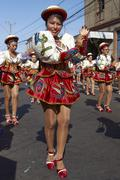 ARICA, CHILE - JANUARY 23, 2016: Caporales Dance Group at the Carnaval Andino. Stock Photos