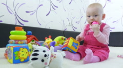 Baby girl sitting on sofa playing toys,little kid early education concept. Stock Footage