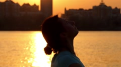 Girl Making Twine at Sunset on the Beach. Yoga Practice Near River. Stock Footage