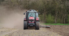 Agriculture tractor manure injection with liquid manure trailer on field Stock Footage