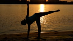 Girl Make Yoga Poses at Sunset on the Beach. Stock Footage