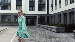 Happy woman walking in the empty city. Slow Motion. - stock footage