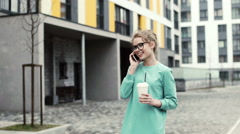 Beautiful woman talking on the phone, laugh - stock footage
