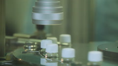 View of a Production Line Machine Conveyor at a Factory Screw Cap on Bottles. Stock Footage