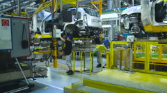 Workers on the Sonveyor Car Production. Car Manufacturing. Work in Process Stock Footage