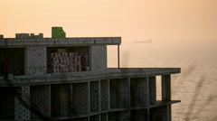 Unfinished building at the coast of the sea Stock Footage