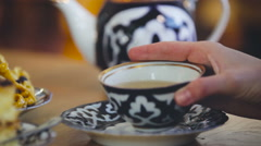 Poured From a Teapot Into a Cup. Utensils For Tea. Beautiful Tableware. Canteen - stock footage