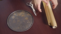Cutting baking paper and coating round baking pan. Kitchen utensils Stock Footage