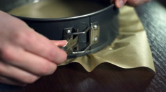 Woman closes a round baking dish. Preparing for baking cake Stock Footage