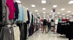 People buying clothes inside Walmart store Stock Footage