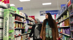 People looking health and beauty products in Walmart store - stock footage
