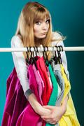 Woman with shopaholic problems. - stock photo