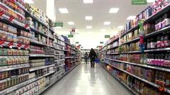 Juice, coffee and tea beverage corridor in Walmart store Stock Footage