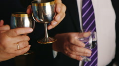 Clinking glasses of  wine in hands - stock footage