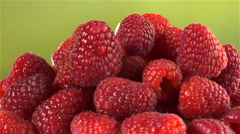 Raspberries isolated rotating on yellow/green background Stock Footage