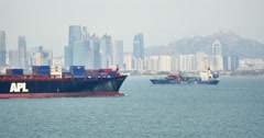 4k Cargo Container Ships Through The QingDao Harbo,moder urban building,china. Stock Footage