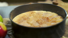 Spreading sugar on apple pie. Sweet food preparation. Making dessert - stock footage