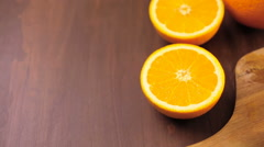 Slices of organic navel orange on cutting board. - stock footage