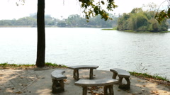 bench at waterside of the pond in the park - stock footage